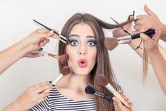 Closeup of beautiful blond girl getting makeup Stock Photography
