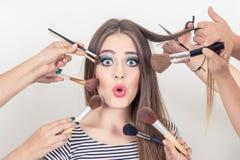 Closeup of beautiful blond girl getting makeup Stock Image