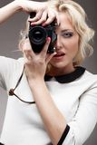 Blonde girl with  retro camera Royalty Free Stock Photo