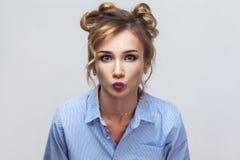 Closeup beautiful blonde woman send  kissing at camera. Royalty Free Stock Image