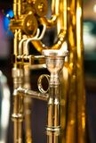 Valve Trombone Focus on Mouthpiece. Closeup of beautiful brass trombone with intricate valves and mouthpiece royalty free stock photos