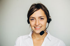 Closeup of a beautiful business customer service woman smiling Royalty Free Stock Images