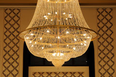 Closeup of a beautiful chandelier light. Beautifully designed crystal chandelier light hanging from the roof Royalty Free Stock Photos