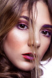 Closeup of beautiful fashion model with makeup and hairstyle on her face. Royalty Free Stock Photos