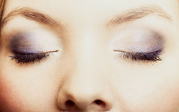 Closeup beautiful female eyes with make-up visage. Stock Photo