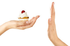Closeup of Beautiful female hand give a rich cupcake Stock Photos