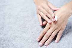 Closeup of beautiful female hands. Applying cream or lotion Stock Images