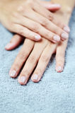 Closeup of beautiful female hands. On towel Royalty Free Stock Image