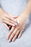 Closeup of beautiful female hands Stock Photos