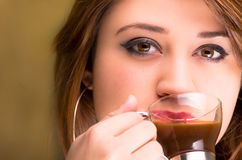 Closeup of a beautiful girl drinking coffee Royalty Free Stock Photos