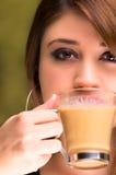 Closeup of a beautiful girl drinking coffee Stock Photos