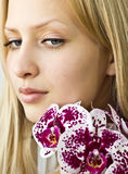 Closeup beautiful girl with orchids Royalty Free Stock Photography