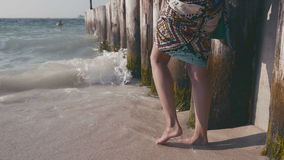 Closeup of beautiful girl in summer dress against the sun flare. stock video footage