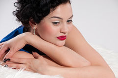 Closeup beautiful glamour woman on white fur Royalty Free Stock Images