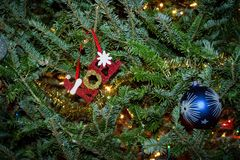 Closeup of Christmas Ornaments. Closeup of a beautiful green Christmas tree with Noel and Blue glass Christmas ornaments stock photography