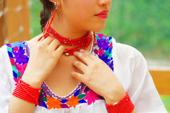 Closeup beautiful hispanic woman wearing traditional andean white blouse with colorful decoration around neck, matching Stock Images