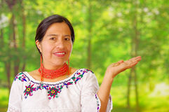Closeup beautiful hispanic woman wearing traditional andean white blouse with colorful decoration around neck, matching Stock Image