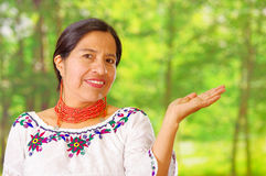 Closeup beautiful hispanic woman wearing traditional andean white blouse with colorful decoration around neck, matching Stock Photography
