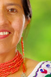 Closeup beautiful hispanic woman wearing traditional andean white blouse with colorful decoration around neck, matching Royalty Free Stock Photo