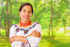 Closeup beautiful hispanic woman wearing traditional andean white blouse with colorful decoration around neck, matching Stock Photo