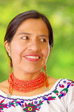 Closeup beautiful hispanic woman wearing traditional andean white blouse with colorful decoration around neck, matching Stock Photos