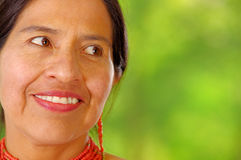 Closeup beautiful hispanic woman wearing traditional andean white blouse with colorful decoration around neck, matching Royalty Free Stock Photos