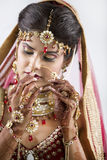 Closeup of Beautiful Indian Bride. Beautiful Indian Bride in jewelry and henna Stock Photo