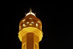 Closeup of beautiful minaret of Al Fateh Mosque of Bahrain at night Royalty Free Stock Photography