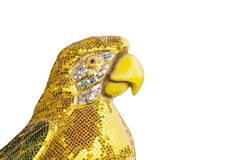 Closeup beautiful parrot bird statue by yellow tiles for decorate isolated on white background with clipping path. Closeup beautiful parrot bird statue by yellow Royalty Free Stock Images