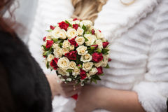 Closeup of a beautiful romantic pink and red roses wedding bouqu. Et in brides hands Stock Image