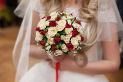 Closeup of a beautiful romantic pink and red roses wedding bouqu. Et in brides hands Royalty Free Stock Photos