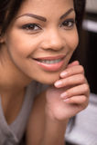 Closeup of beautiful smiling african woman. Stock Photos