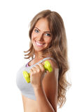 Closeup of a beautiful smiling woman with dumbbells Royalty Free Stock Images