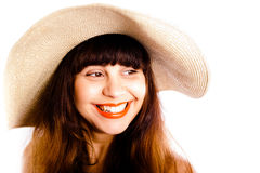 Closeup of a beautiful smiling woman wearing a hat Stock Photography