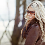 Closeup of a beautiful smiling woman wearing sunglasses Stock Photography