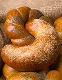 Closeup of a beautiful still-life from bread, pastry products wi. Th wheat ears, poppy seeds and buns. High resolution studio image Stock Images
