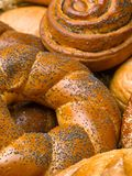 Closeup of a beautiful still-life from bread, pastry products wi. Th wheat ears, poppy seeds and buns. High resolution studio image Stock Image