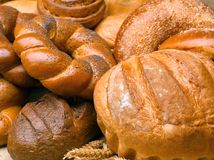 Closeup of a beautiful still-life from bread, pastry products wi. Th wheat ears, poppy seeds and buns. High resolution studio image Stock Photography