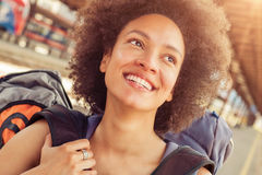 Closeup of beautiful tourist traveler standing with huge luggage Royalty Free Stock Images