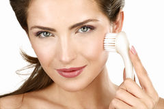 Closeup of a beautiful woman applying a beauty treatment Royalty Free Stock Photo