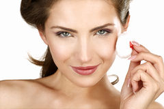 Closeup of a beautiful woman applying a beauty treatment Royalty Free Stock Photos