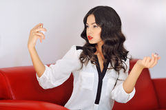 Closeup of a beautiful woman applying perfume Royalty Free Stock Photography