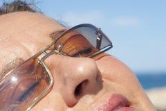 Closeup of beautiful woman enjoying the sunshine Stock Photo
