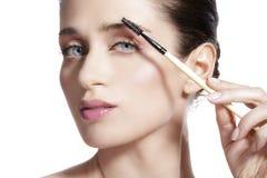 Closeup beautiful woman with eyebrow brush tool Royalty Free Stock Images