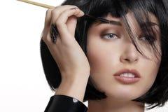 Closeup beautiful woman with eyebrow brush tool Stock Image