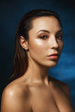Closeup of beautiful woman with fashion make up, looking straight. Stock Image