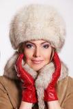 Closeup of a beautiful woman in fur Stock Images