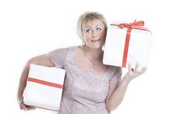 Closeup.beautiful woman with gift boxes.isolated on a white. Background Royalty Free Stock Photo
