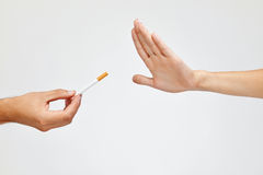 Closeup Of Beautiful Woman Hand Refusing To Take Cigarette Royalty Free Stock Photography