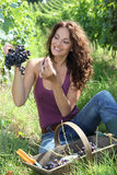Closeup of beautiful woman holding grapes Stock Photos